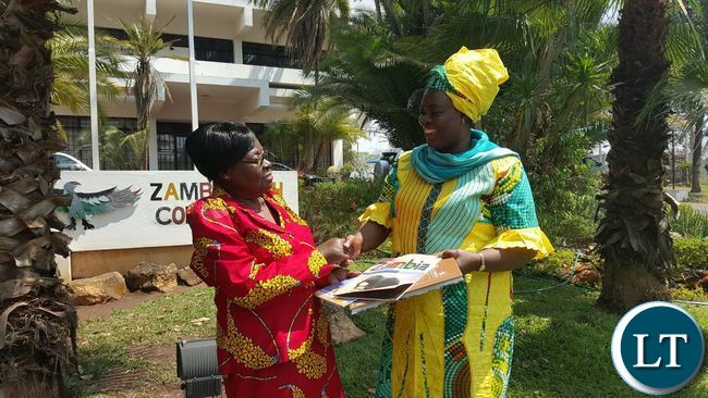 Tourism and Arts Minister Jean Kapata (right) presents tourism materials and books to Zambia's High Commissioner to Malawi Salome Mwananshiku at the Chancery in Lilongwe