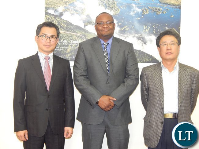 High Commissioner His Excellency Mr. Mwamba with representatives from KEPCO KPS, Mr. Jason Lee (left) and LG International, Mr. Dow Lee after the meeting at the High Commission in Pretoria