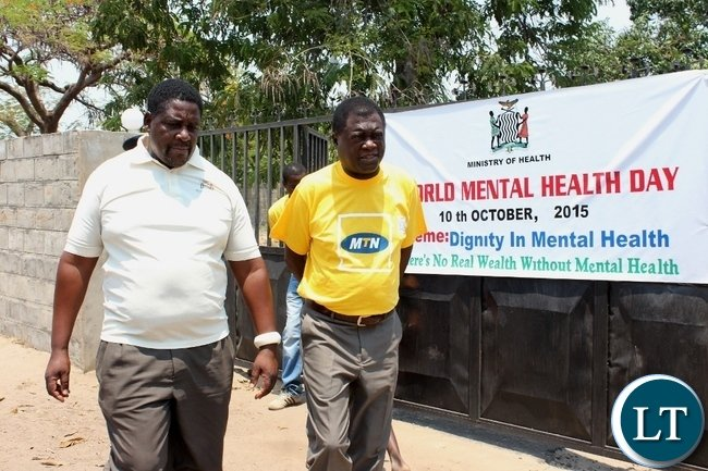Lewanika General Hospital Principal Clinical Officer Charles Kalangwa (l) with Mongu District Commissioner Susiku Kamona (r) after visiting mental patients wards during the commemoration of World Mental Health Day at Lewanika General Hospital in Mongu