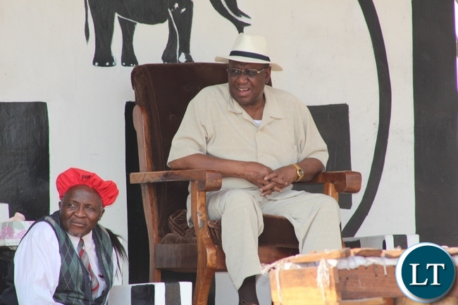 His Majesty the Litunga Lubosii Imwiko II (r) shares a light moment with Western Province Permanent Secretary Mwangala Liomba (c) during the 15th Anniversary of the Coronation of His Majesty the Litunga in Limulunga Royal Village of Limulunga District