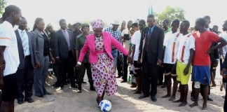 Vice President Inonge Wina (c) kicks the ball to officially kickoff the Inonge Wina Independence Football Championship Tournament in her constituency in Nalolo District