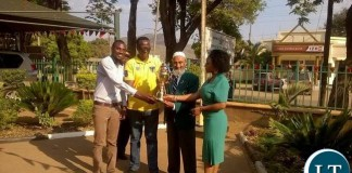 L-R:Provincial Acting Youth Coordinator Trywell Moonga, Eastern Province Permanent Secretary Chanda Kasolo, National Sport Council of Zambia Board Member Haroon Ghumra and provincial sports coordinator Rhoda Goma holding an independence trophy donated to Eastern Province by sport council in Chipata