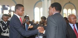 President Lungu greets UPND president Hakainde Hichilema during the memorial service of the Late President Michael Chilufya Sata at St Ignatius Catholic Church in Lusaka