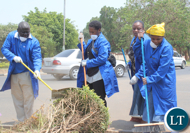 """OFFICE of the Vice President Deputy Minister Chungu Bwalya at the extreme left during the cleaning at Cabinet Office premises; Cabinet Office Members of the Staff converged at Cabinet Offica in order to take part in """"Keep Zambia Clean Campaign"""" on Saturday, 3rd October 2015"""
