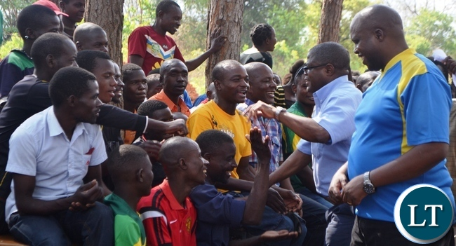 MALOLE MP Christopher Yaluma accompanied by Simon Mwila greets residents at Rosa Mission.Picture by KENNEDY MUPESENI