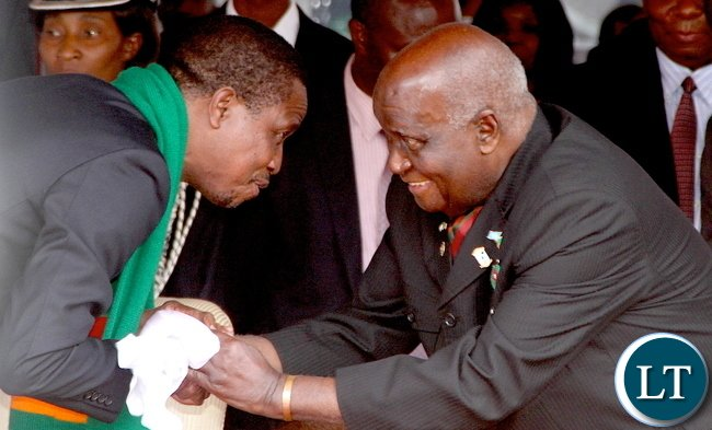 President Edgar Chagwa Lungu greets First Republican President Dr Kenneth Kaunda during Zambia's 51st Independence anniversary Celebration at Heroes Stadium in Lusaka on Saturday, October 25,2015 -Pictures by THOMAS NSAMA