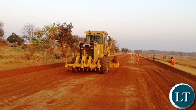 Government recently awarded Build Trust Construction Limited a K95 million project for the tarring of selected urban township roads in Sinda District of the Eastern Province.Here works on Great East -Chassa road going on