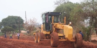 Government recently contracted China Geo Engineering company to upgrade 20.5 kilometers of selected Solwezi urban roads to bituminous standard at a total cost of K220 million. Above, a grader mixes a road in readness for compact on Mushindamo street in Solwezi