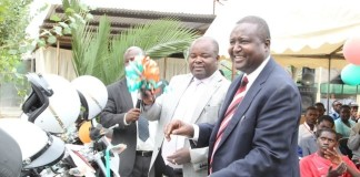 Deputy Minister of Youth and Sports, Ronald Chitotela(m) Zambia Country representative for UNICEF,Hamid El –Bashir Ibrahim at the handover ceremony of motor Bikes by United Nations Children' Fund(UNICEF) to the Ministry of Youth and Sports in Lusaka t