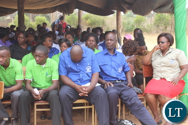 "DOZING ON DUTY! An unidentified teacher dozes off during the delivery of speeches at the Provincial Teachers Day event held in Monze today under the theme, ""Empowering Teachers, Building Sustainable Societies""."