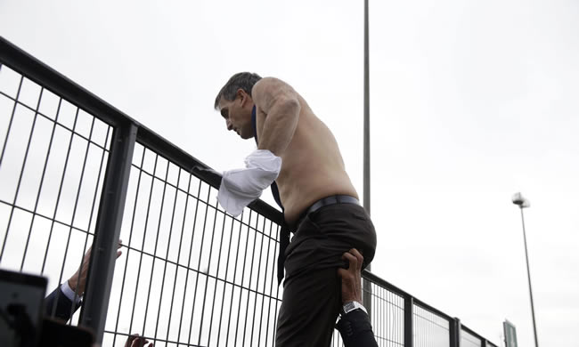 Air France's human resources director, Xavier Broseta, tries to climb a fence to escape angry employees. Photograph: Kenzo Tribouillard/AFP/Getty Images