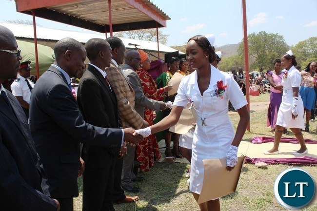 CAROL Mukanga, from Chipata General hospital, shakes hands with dignitaries after receiving a certificate during the graduation ceremony of nurses and midwives from Mwami Adventist, Chipata General and St. Francis schools of nursing held in Chipata