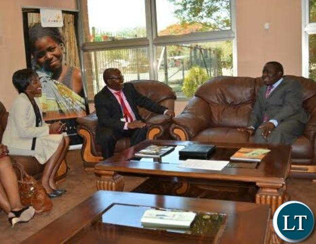 Foreign Affairs Minister Harry Kalaba (right) talks to ZAPRA president Davies Mudenda (middle) as ZAPRA secretary Mwamba Siame (left) look on upon his arrival at Harry Mwaanga Nkumbula International Airport in Livingstone