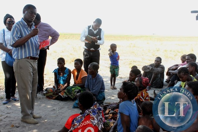 Mongu District Commissioner Susiku Kamona addressing victims of Imuba Village of Katongo Lower area in Mongu whose entire village was burnt to ashes onSunday, October 18, 2015. Government through the Disaster Management and Mitigation Unit (DMMU) will provide support to these victims.