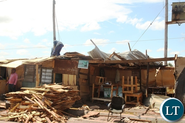 Baulini Resident renovete the roof after it was blown off due to heavy rains in Baulini