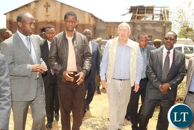 DMMU Coordinator Patrick Kangwa shows round the affected area in Baulini to President Edgar Lungu and PF Lusaka Central Member of Parliament Guy Scot during the tour of the effected houses in Baulini