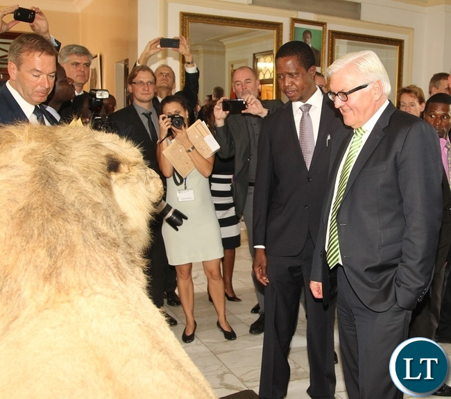 President Edgar Lungu shows the Federal Minister of Foreign Affairs Dr. Frank-Walter STEINMEIER a lion at State House Yesterday 20-11-2015. Picture by ROYD SIBAJENE/ZANIS