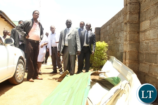 President Edgar Lungu looking at the roof that has been blown of at Baulini clinic due to heavy rains in Baulini