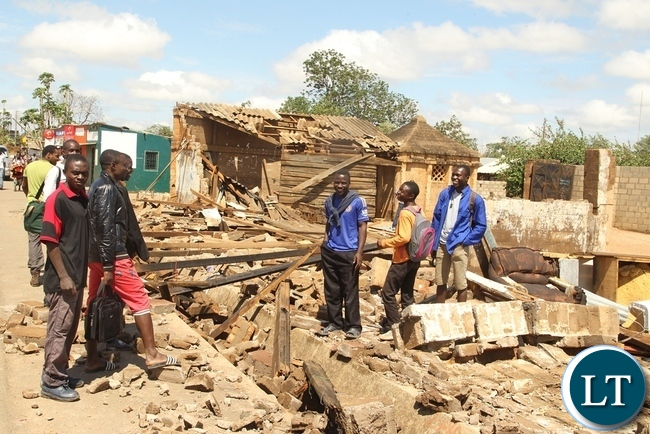 Baulini Resident looks helpless and in pain on the House destroyed due to heavy rains in Baulini