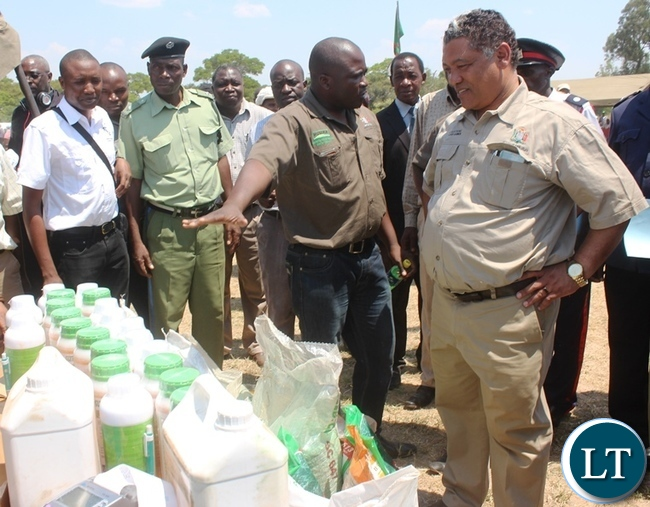 Agriculture Minister Given Lubinda (right) checking on Agric Chemicals on display during the Farmer Input Support Programme (FISP) E- Voucher launch at Mpima dairy in Kabwe on Saturday
