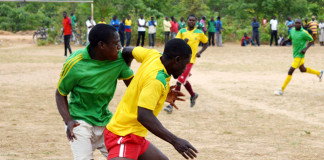Limpo Siachaba (in green jersey) of Mochipapa Research football club fight for the ball with Moses Muleya of Sikalongo football club in which the two teams drew 1-1 at the weekend. Insert, Patriotic Front Member of the Central Committee Syacheye Madyenkuku (holding balls) with Choma central Constituency party secretary Joel Kamoko (left) and Constituency chairperson Timothy Siakaziba (immediate right) about to present footballs to the winner of the Sikalongo ward tournament