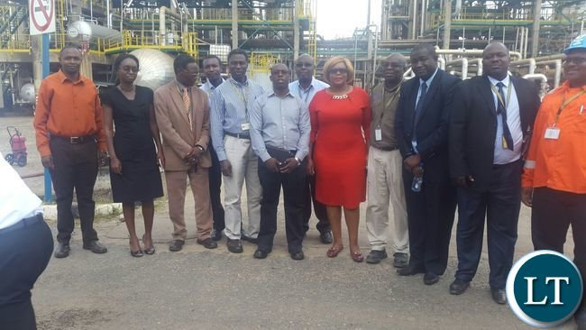 Dora Siliya with officials from Indeni