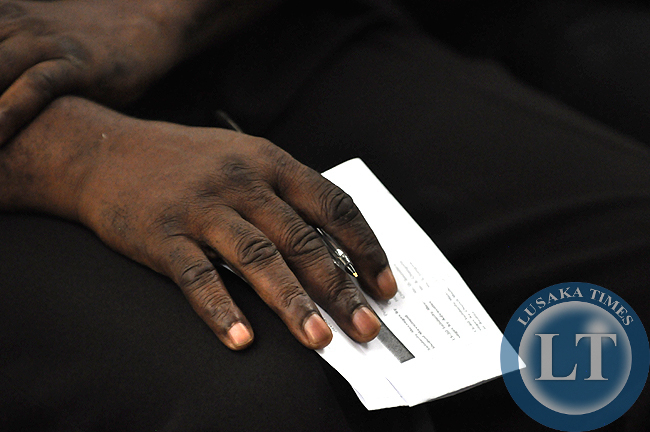 Heritage Party leader Brigadier Godfrey Miyanda holds a note and pen during the meeting to demand for the release of the draft Zambia constitution
