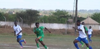 Lumwana striker tries to dribble Zesco's Gerald