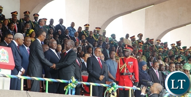 Newly elected Tanzanian President Dr John Pombe Magufuli greets Rwandan President Paul Kagame whilst other president look on during the Inauguration ceremony at the Uhuru Stadium in Dar es Salaam.