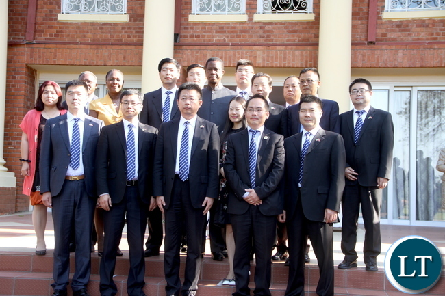 President Lungu pose for a photograph with Chinese Business men when they paid a Courtesy call on him at State House on Monday, November 9,2015 -picture by THOMAS NSAMA