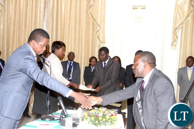President Lungu with Vice-President Inonge Wina, Commerce minister Margaret Mwanakatwe and newly appointed Commerce deputy minister Raymond Mpundu after the swearing-in-ceremony at State House on Tuesday, November 10,2015 -Picture by THOMAS NSAMA