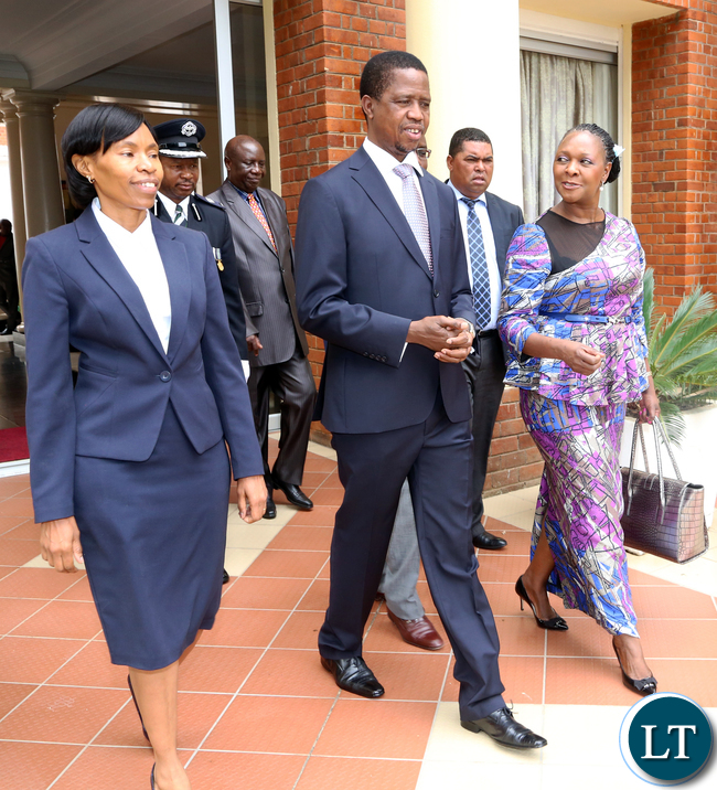 PRESIDENT Edgar Lungu with  Kayula Siame as Ministry of Commerce, Trade and Industry permanent secretary and  Minister of Commerce, Trade and Industry, Margaret Mwanakatwe.at State hose after the swearing in Ceremony. Picture  by Eddie Mwanaleza/State house. 20-11-2015.