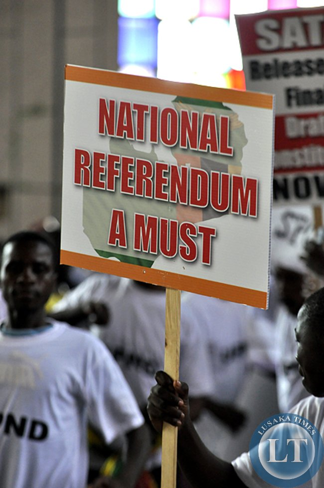 FILE: UPND youths carry a placard to demand for the referendum as the mode of adopting the controversial draft constitution