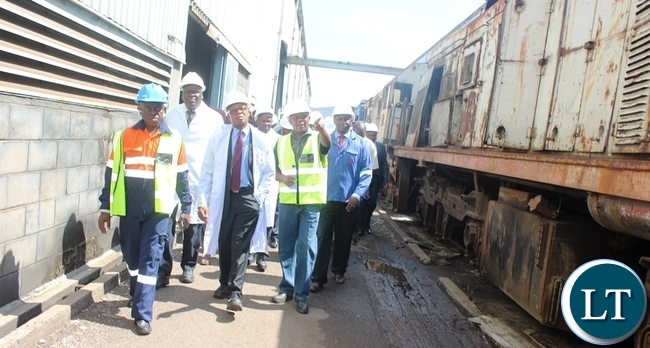 From (right) Zambia Railways Director Rolling Stock Webster Mtambo, Transport and Communications Minister Kapembwa Simbao and his deputy James Kapyanga during the tour of Zambia Railways workshop in Kabwe