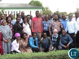 President Edgar Lungu poses for a photograph with teachers from Ibenga girl's secondary school in Mpongwe shortly after visiting the facility.