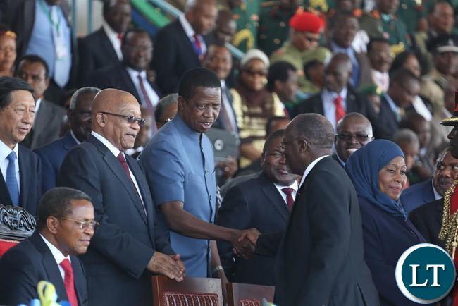 President Edgar Lungu shakes hands with newly elected Tanzania President Dr John Pombe Magufuli at the Inauguration ceremony in Dar es Salaam, Tanzania