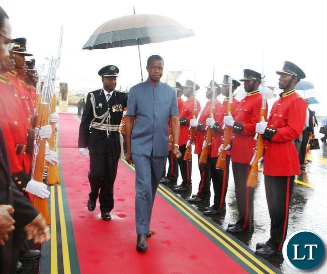 President lungu inspects the guard of honour on arrival at Julius nyerere international airport.