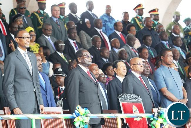 President Edgar Lungu (far right), President of Rwanda Paul Kagame (left), Zimbabwean President Robert Mugabe (second left) and South African president Jacob Zuma follow proceedings during the Inauguration of newly elected Tanzania President Dr John Pombe Magufuli at Uhuru stadium in Dar es Salaam, Tanzania.