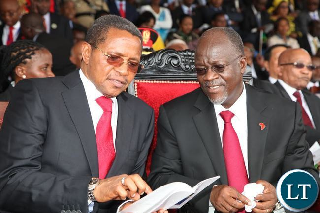 Out going Tanzania president Kakaya Kikwete talks to newly elected president Dr John Pombe Kikwete at the inauguration ceremony at uhuru stadium in Dar es Salaam, Tanzania,