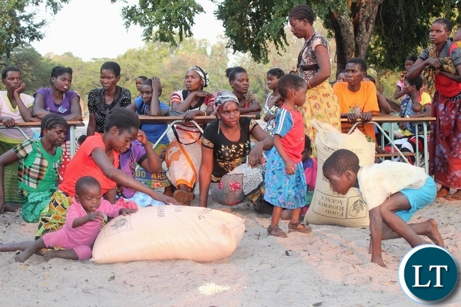 Spastic Paralysis (Konzo) disease victims collect relief maize bags from the government Lwatembo Primary School in Mongu