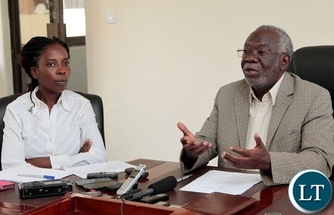 Labour Minister Fackson Shamenda briefing Journalists in his office