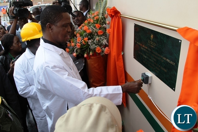 President Edgar Lungu unveil the plaque during the commissioning of the 330kv Pensulo-Kasama power project