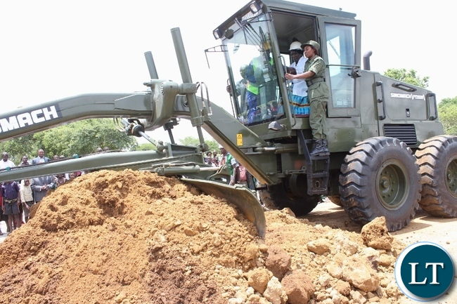 Acting President Inonge Wina operating a grader for Zambia National Service (ZNS) during the launch of Countrywide Feeder Roads Rehabilitation Project worth K16.2 billion in Litoya area of Nalolo District in Western Province