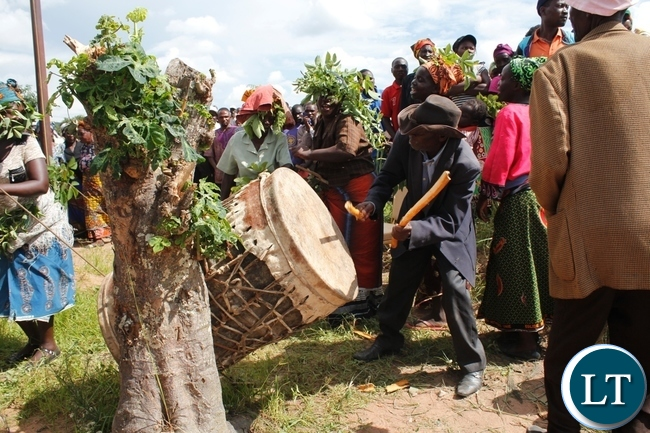 A traditionalist beating the drum to signify the arrival of the body of the late Chief Fwambo of the Mambwe people in Mbala at the funeral house in Kawimbe
