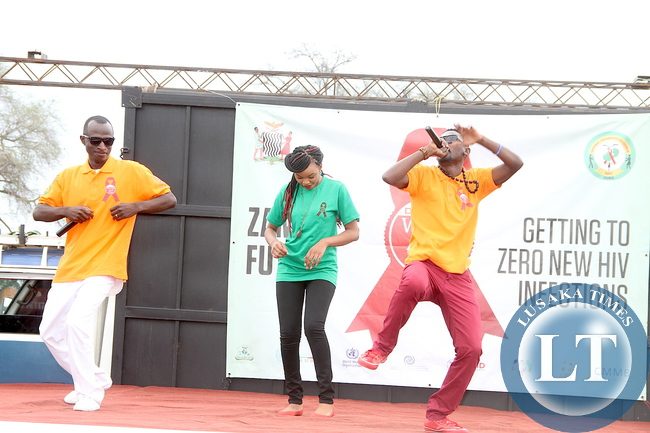 Macky 2, Franciar and B-flow performing during the World AIDS day Commemoration march past in Livingstone on Monday, December 1,2015 -Picture by THOMAS NSAMA