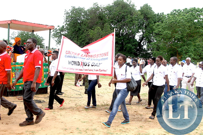 Caritas Livingstone march past First Lady Esther Lungu during the World AIDS day Commemoration march past in Livingstone on Monday, December 1,2015 -Picture by THOMAS NSAMA