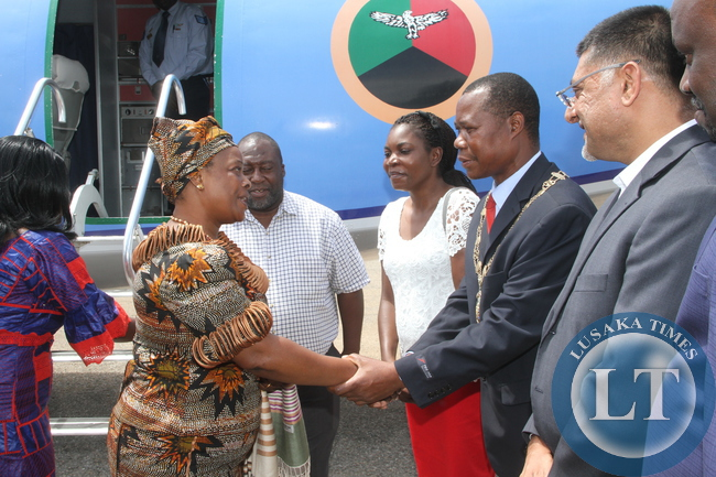 First Lady Esther Lungu being welcomed by Chingola mayor Titus Tembo on arrival at Kasompe Air stripe on Monday, December 7,2015 to check and witness various projects that are being undertaken by various stakeholders and those that are undertaken by Konkola Copper mine (KCM) under Cooperate Social responsibility -Picture by THOMAS NSAMA