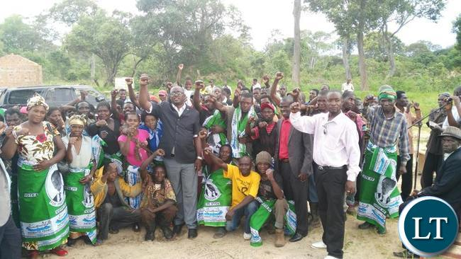 Dawson Kafwaya raises the fist, the PF party symbol after  addressing a party meeting in Solwezi on Sunday