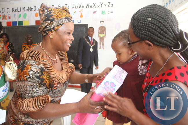 First Lady Esther Lungu presents Christmas gifts to nursery School children at Ndeleni Children Centre that was initiated by KCM at Chiwempala Market in Chingola on Monday, December 7,2015. The First Lady is in Chingola to check and witness various projects that are being undertaken by various stakeholders and those that are undertaken by Konkola Copper Mine (KCM) under Corporate Social responsibility -Picture by THOMAS NSAMA