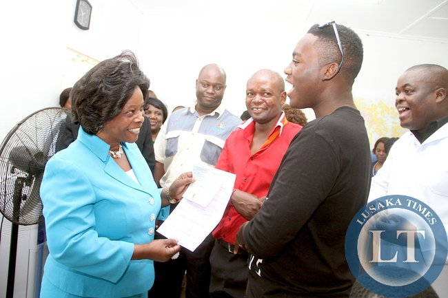 First Lady Esther Lungu share a light moment with Late President Michael Sata's son Gerald (in a black top) during a tour of State House clinic. Gerald Sata was at the clinic for medicals for a drivers license in Lusaka on Thursday, December 10,2015 -Picture by THOMAS NSAMA